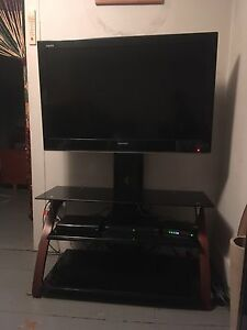 "42"" Sharp Aquos TV w/ 3 shelf pivoting stand"