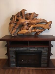 Handmade, one of a kind, crafted wood art for wall or fireplace.