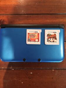 3DS xl with pokemon sun and mario 3d land