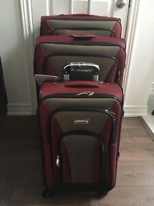 Brand new lightweight four wheels luggage (expandable)
