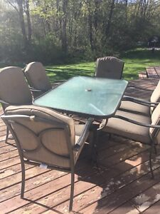 Patio table with 6 chairs and cushions