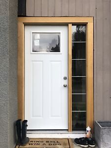 Steel front entry door with side light