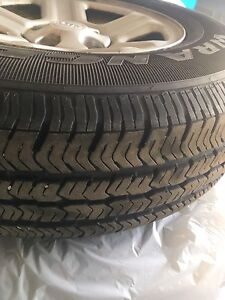 5 GOODYEAR WRANGLER ST ALL SEASON TIRES AND RIMS