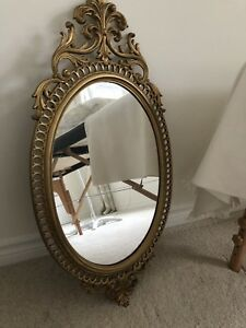 wall mirror with gold frame