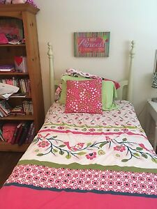 Twin matching four poster beds
