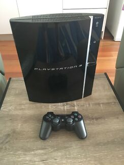 Sony PlayStation 3- 80gb console-controller- 8 games.