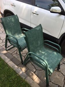 4 Green wicker and steel lawn chairs $35