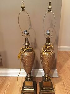 A pair of gold table lamps