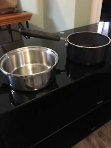 Two Used Full Kitchen Pot Sets w/ covers