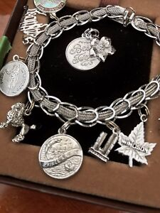 Silver Charm Bracelet with  10 Silver Charms.