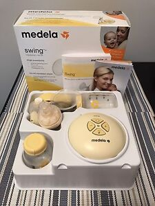 Medela Swing Breast Pump, Bottles and Nursing Pads