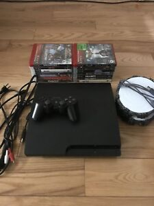 Mint PlayStation 3 for sale with all cords and lots of games