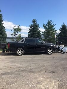 2010 Chev Avalanche LTZ 4x4 with plow and salter