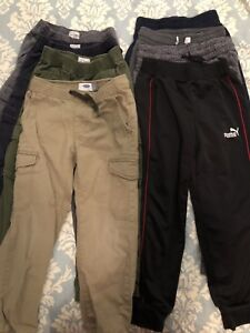 8 pairs of boy size 6 and 6/7 pants