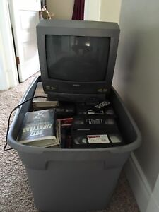 Tv with VHS and approx 90 kids movies