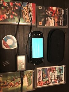 PSP 1001 with 5 games and memory card