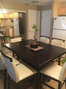 Selling my dining table with six bar leather chairs