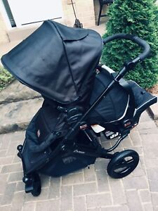 Double Britax stroller with car seat