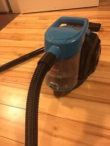 A small Biselle Canister Vacuum