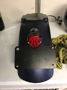 Triumph retro tail light and shock mounted turn signals