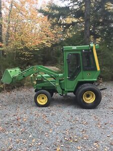 John Deere 855 with blower and cab