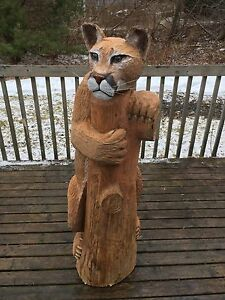 Cougar chainsaw carving