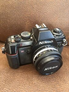 Nikon N2000 SLR 35mm with two lenses.