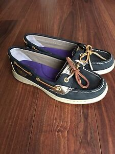 Black and gold Sperry boat shoes