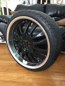 5 bolt 20 inch RUFFINO rims with low profile tires