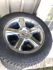 """Chevy 20"""" rims and winter tires."""