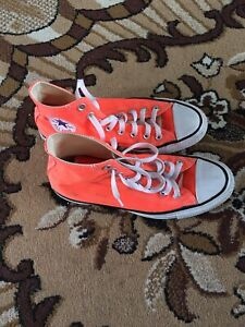 Orange converse hi-tops
