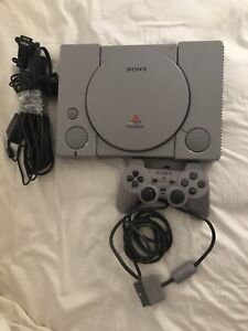 Sony play station 1 with 1 controller and 2 games