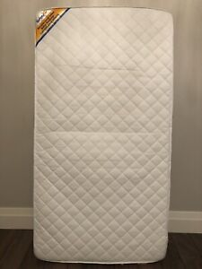 Crib mattress for baby/toddler with waterproof mattress pad!
