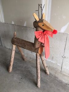 Rudolph outdoor decor made of carved logs