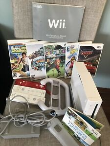 Wii with games mat and controllers