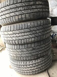 Set of 4 all season tires (no rims) 235/60/17