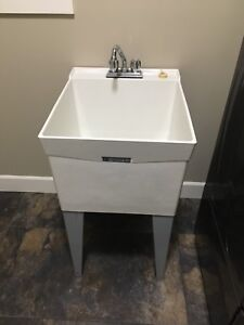 Laundry tub and taps