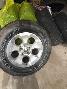 5 stock Jeep tires and rims