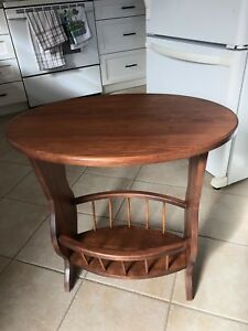 Oval basswood table with cherry finish
