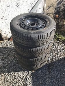 215/60 R16 winter tires rims with hubcaps. Ford 5 bolt pattern.