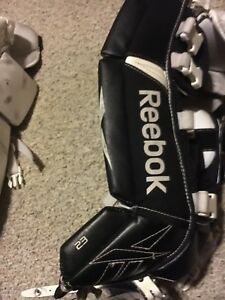 "23"" youth goalie pads, glove, and blocker"