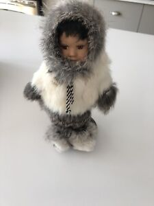 Collectable porcelain doll with real fur