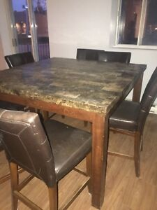 """Table and 7 24"""" chaire in good condition"""