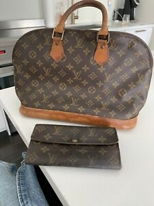 Authentic Louis Vuitton Alma with matching wallet $550