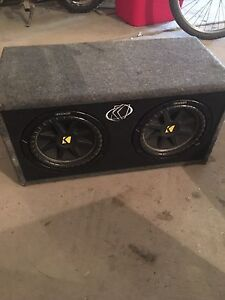 Two 10 inch subs, one 12 inch sub, an amp and a deck.