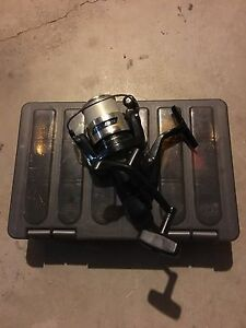 Used fishing reel with tackle box