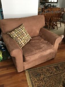 2 brown micro suede chairs