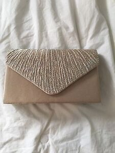 Beige clutch with strap