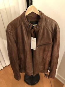 Danier leather brown biker jacket, large, new with tags.