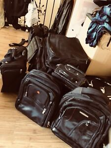 Computer bags, backpacks, suitcases,; some leather